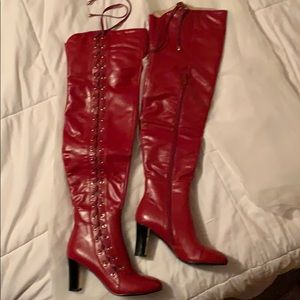 Red high boots. Zipper on side.